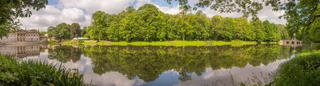 Warsaw, Poland - June 01, 2019: Panoramic view of Royal Baths Park in spring time, Baths Park, Lazienki Park and Palace on the Water