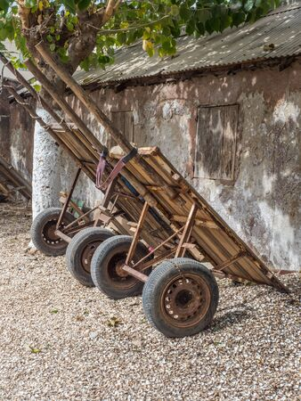 Joal-Fadiouth, Senegal - January 24, 2019: A few carts are standing next to the building on the island Joal-Fadiouth. Town and commune is in the Thiès Region at the end of the Petite Côte of Senegal. Africa.