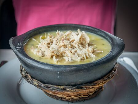 Traditional dish from Colombia - Ajiaco soup, made of chicken, corn and potatos, especially famous in Bogota, Colombia, South America. Stock fotó