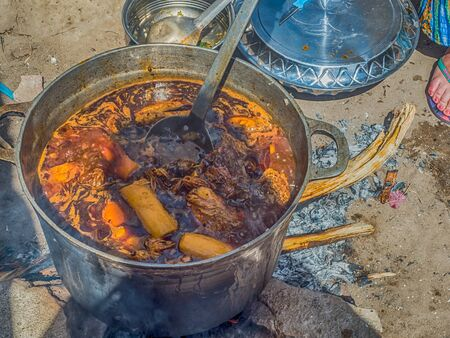 Cooking a typical Senegalese dish for the big family. The name is Yassa chicken. Senegal. Africa.