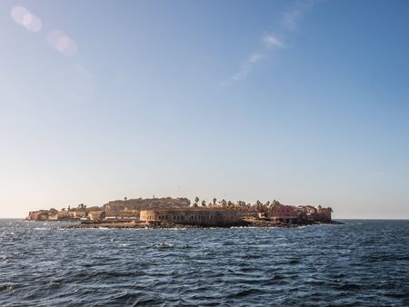 View of island Goree with fort and Dakar city visible in the background. Gorée Island. Dakar, Senegal. Africa. Île de Gorée.