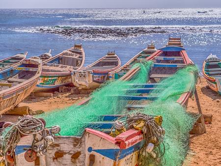 Dakar, Senegal - February 2, 2019: Colored, wooden, fisher  boats on the sandy beach of Dakar,   Africa
