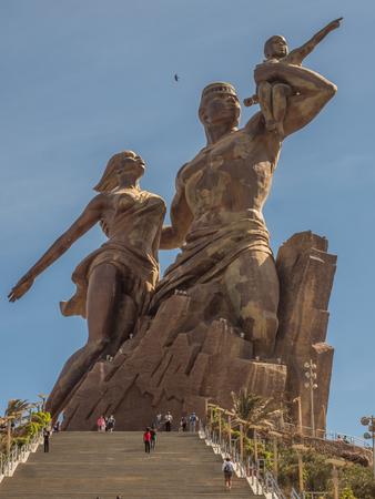 Dakar, Senegal - February 02, 2019: Images of a family at the African Renaissance monument, in the India Teranca Park near the coast. Monument de la Renaissance Africaine. Africa
