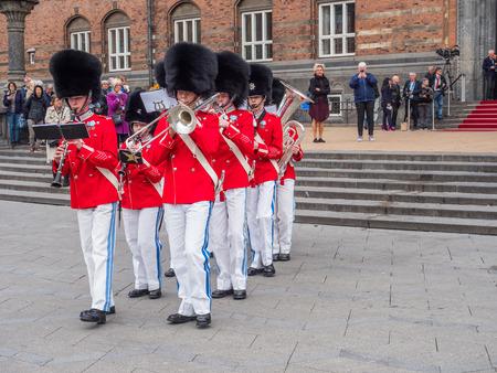 Copenhagen, Denmark - May 28, 2019: The Tivoli Gardens Youth Guard band in red gala uniform next to City Hall   in Kopenhagen, Denmark, Drums and Fifes, 報道画像