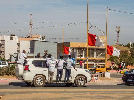 Dakar, Senegal - February 3, 2019: Africans on the car during a street manifestation in the election period. Africa.