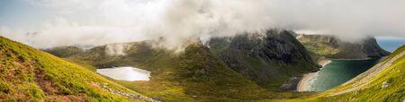 Lofoten, Trail to Ryten and panoramic view for the Kvalvika Beach, Norway 写真素材