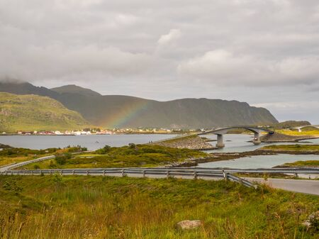 Panoramic view for the bridge and rainbow on the road Fv 808 to the Fredvang, Fredvang bro. Lofoten, Norway 写真素材