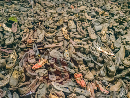 Auschwitz, OÅ›wiÄ™cim, Poland - June 05, 2019: The shoes from the people who were killed in Auschwitz. The biggest nazi concentration camp in Europe during World War II 新闻类图片