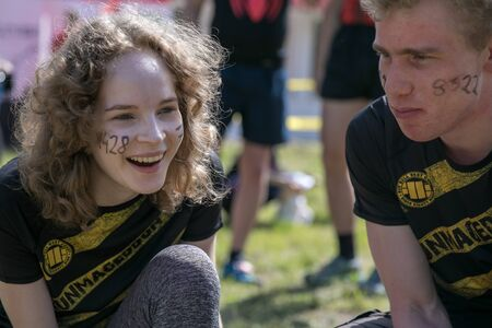 Portrait of young boy and girl  before extreme running with obstacle RUNMAGEDDON