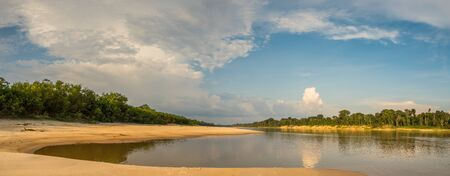 Sandy beach at the Javari River, the tributary of the Amazon River, during the low water season. Amazonia. Selva on the border of Brazil and Peru. South America. Stok Fotoğraf