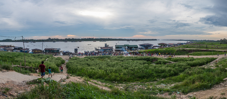 Tabatinga, Brazil - September 14, 2019: Panoramic view for port on Amazon river during low water season. South America. Amazon River.  Border of Colombia, brazil and Peru. Rain Forest of Amazonia.