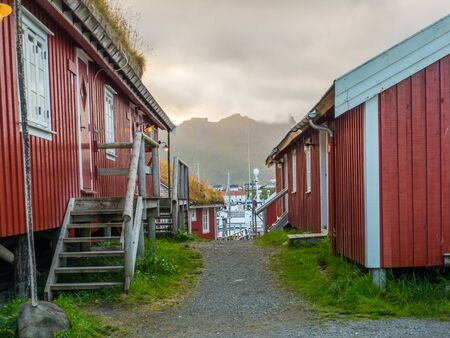 Traditional, red, wooden houses in Reine. Lofoten Norway. Europe. Stok Fotoğraf - 137486780