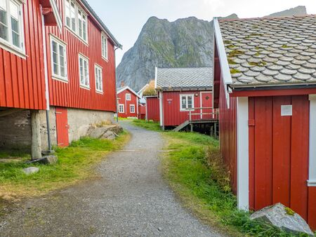 Traditional, red, wooden houses in Reine. Lofoten Norway. Europe. Stok Fotoğraf - 137495566