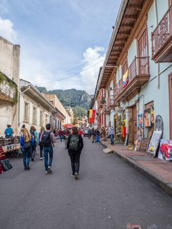 Bogota, Colombia - November 28, 2019: Street of Bogota with colonial colorful houses and mountain view in the background, La Candelaria district. Editöryel