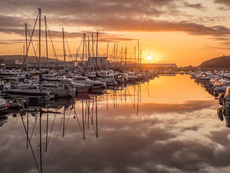 Ronvikleira, Bodo, Norway - August 18, 2019: View of the marina and sailing boats during the sunset. Yacht port located in the port of Bodo. Nordland. Europe. Gate to Lofoten Editöryel