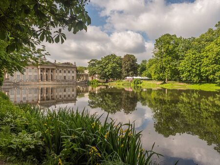 Warsaw, Poland - June 01, 2019: View of Royal Baths Park in spring time, Baths Park, Lazienki Park and Palace on the Water