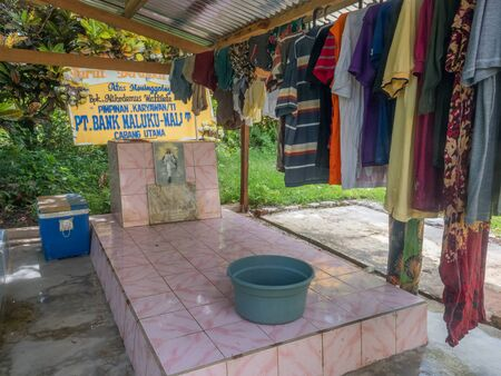 Ambon, Maluku, Indonesia - February 11, 2018: The colorful graves of a family members in the yard next to the house on Ambon Island, Editöryel