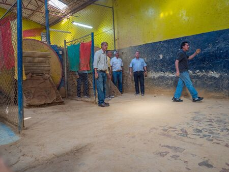 Bogota, Colombia - Septemebr 12, 2019: Colombian men are playing tejo game in the local tejo club.Tejo, also known, to a lesser degree, as turmeque, is a traditional throwing sport in Colombia. Editöryel