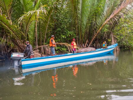 Kensi, Arguni,  Indonesia - February 06, 2018:  Wooden boat with local people during the trip to the Kensi village on West Papua, Indonesia Editöryel