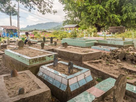 Ambon, Indonesia - February 11, 2018: Local muslim cemetery in the small town on Ambon Island, Maluku