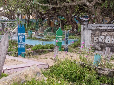 Kaimana, West Papua, Indonesia - February 7, 2018: Local cemetery in the small town on Birds Head Peninsula. Cenderawasih Bay.
