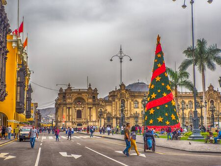 Lima, Peru - December 12, 2019: Big Christmas tree waiting for a Christmas time in Lima.  In the background Government Palace, Plaza de Armas, Peru, South America. Latin America