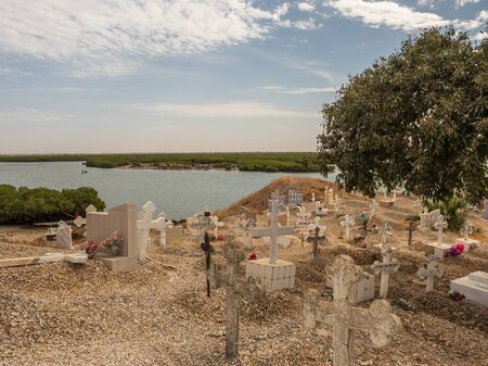 Joal-Fadiout, Senegal - January, 26, 2019: View of Mixed Muslim-Christian Cemetery. Joal-Fadiouth town and commune in the Thiès Region at the end of the Petite Côte of Senegal. Africa.