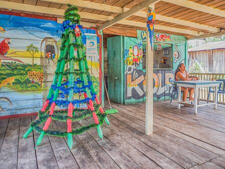 Santa Rosa, Peru - December 10, 2017: A Christmas tree made from the green bottles waiting for a Christmas time in Santa Rosa, Peru, South America. Editöryel