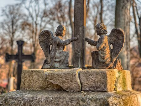 Užupis, Vilnius, Lithuania - April 08, 2018: Bronze Angels on a tomb on local  cemetery in Vilnus, Europe