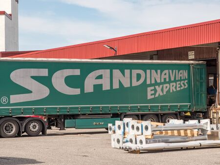 Bodo, Norway - August 18 2019: Container at the ramp. Scandinavian Shipping Logistics. Bodo. Norway. Editöryel
