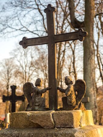 Užupis, Vilnius, Lithuania - April 08, 2018: Bronze Angels and cross on a tomb on local cemetery in Vilnius, Europe Editöryel