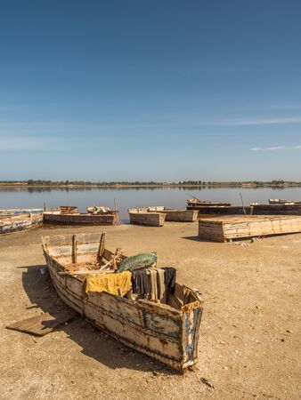 Lac Rose, SenegalL - Feb 02, 2019: Wooden boats on the coast of the Lake Retba. Africa