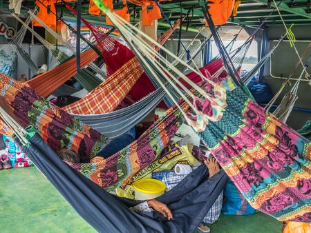 Amazon River, Peru - March 25, 2018: Beautiful, colorful hammocks on the cargo boat Editöryel