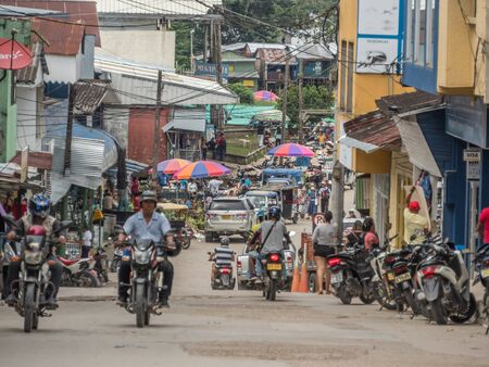 Leticia, Amazonas, Colombia, DEc 07, , 2019: Various rickshaws, motors and cars  on a  street of a small town.  Amazonia. Latin America. Colombia Stok Fotoğraf