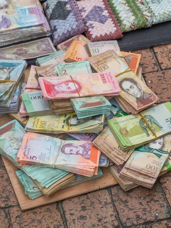 Stack of Worthless Venezuelan currency (Bolivar Fuerte) on the street of Bogota.  Due to hyperinflation  it is better to use banknotes to make purses and sell as souvenirs. Colombia