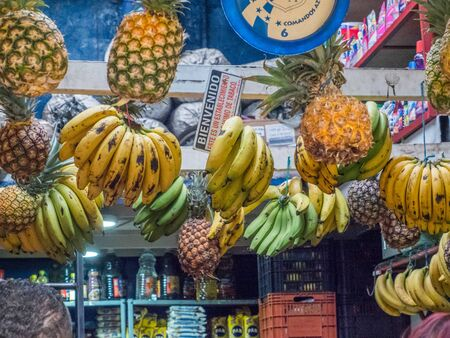 Bogota, Colombia - November 28, 2019: Tasty, fresh, colorful fruit and vegetable hanging on a market stall in a small town Editöryel