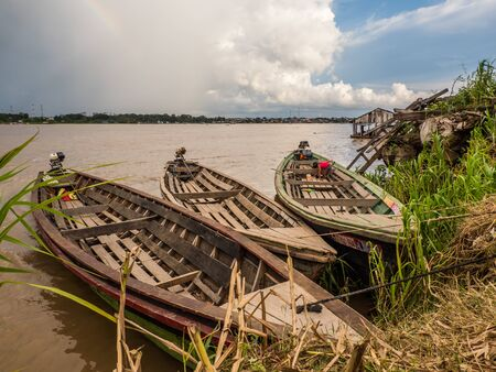Santa Rosa, Peru - December 12, 2019: Huge wooden boats in  the port of Amazon river. South America. Amazon River.  Tres fronteras. Rain Forest of Amazonia.