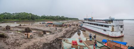 Amazon River, Peru - Sep 22 , 2019:  Panoramic view of ferry boats on the bank of the Amazon River during the low water seaoson.  South America.