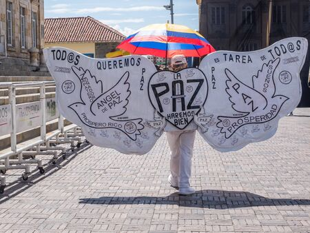 Bogota, Colombia - December 12, 2019:  A Angel of peace.  on the main square. The inscription on the wings reads: We all want less poverty, more prosperity and work, job for everyone, we all want peace.  Peace will do well Editöryel