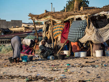 Senegal, Africa - January 25, 2019: African women working on sorting caught fish and other sea creatures Éditoriale