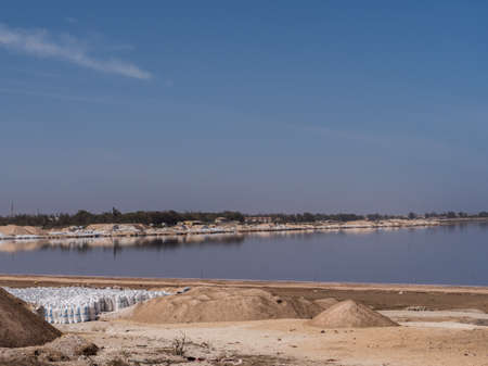 View of Lac Rose (meaning Pink Lake). Lake Retba with the red water . Llies north of the Cap Vert peninsula of Senegal. Africa.