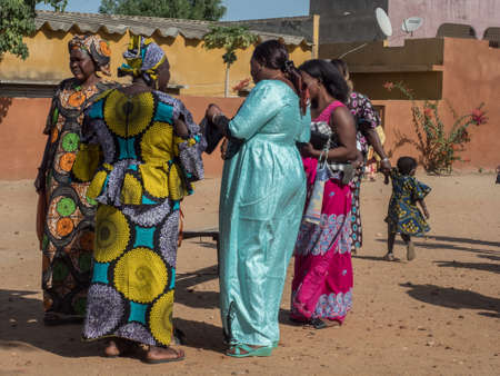 Senegal, Africa - January 2019: African women in their colorful clothes (boubou) meet after the mass at a Catholic church in West Africa Éditoriale