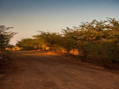 Africa's red dirt road. Senegal, Africa Banque d'images