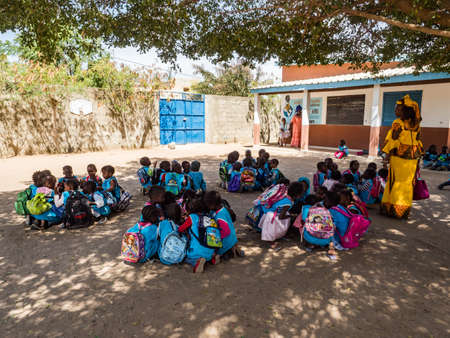 Senegal, Africa - Jan 2019: Senegalese children eat at school together in a traditional way. Senegal Africa. Publikacyjne