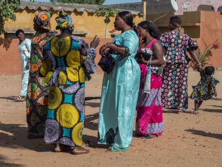 Senegal, Africa - January 2019: African women in their colorful clothes (boubou) meet after the mass at a Catholic church in West Africa Publikacyjne