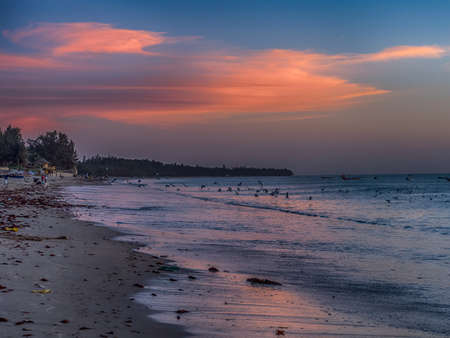 Sunset on the sandy beach at Atlantic coast in Africa, Senegal, West Africa