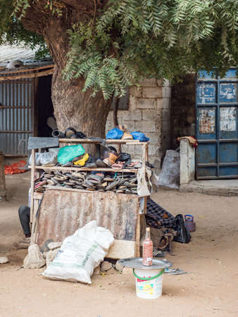 Senegal, Africa - Jan 2019: Used shoes sold at a street market stall in a small town in Senegal, Africa 免版税图像
