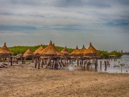 Granaries on a shell island among mangrove trees, Joal-Fadiouth, Senegal Africa