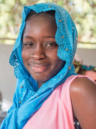 Nianing, Senegal - January 24, 2019: Portrait of beautiful Senegalese young woman. Africa 新闻类图片