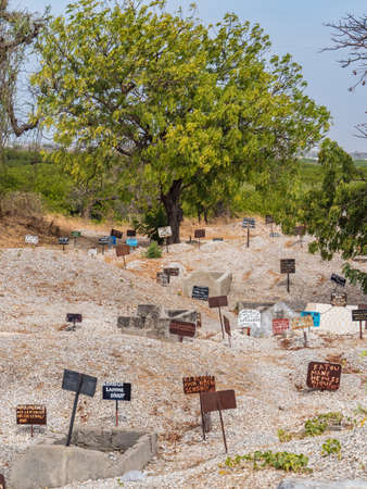 Joal-Fadiouth, Afrika - Jan, 2019: Metal tablets on the tomb of mixed Muslim-Christian cemetery. The city and municipality of Joal-Fadiouth in the Thiès region at the end of the Petite Côte of Senegal